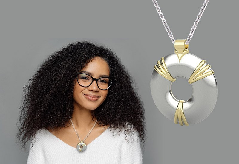 girl with glasses and a silver and gold pendant