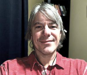 man in red shirt smiling
