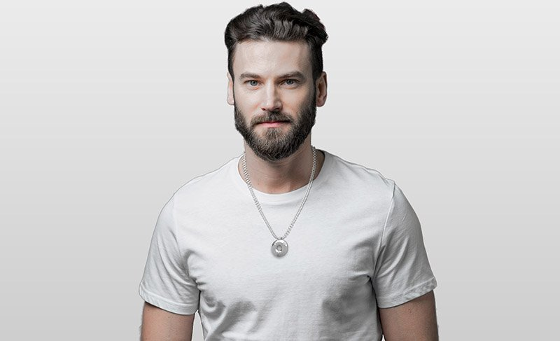 white male wearing Aulterra Energy Pendant all silver